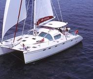 Catamaran Privilege 495 for hire in Marina Porto Colom
