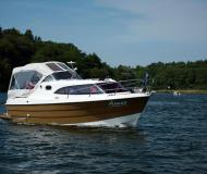 Motor boat Dominator 780S Deluxe available for charter in Marina Eldenburg